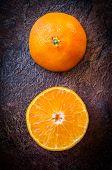 image of mandarin orange  - Orange mandarin tangerine cut half top view - JPG