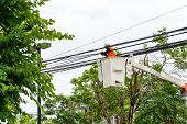 picture of hydraulics  - Electrician repair of electric power cable on hydraulic platform - JPG