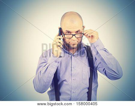 Bald Man Businessman Talking On Phone.