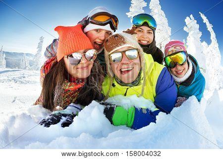 Group of happy friends having fun. Snowbarders and skiers group team friendship. Sheregeshs ski resort