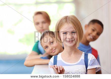 Cute kids in school hallway