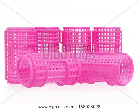 pink hair curlers, isolated on white background