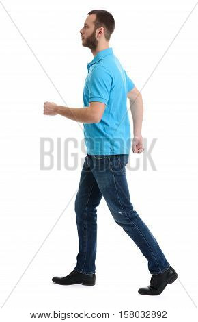Casual Bearded Man Walking Over White Background