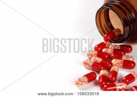Red Medical Capsules And Bottle Isolated