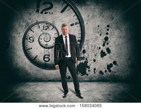 full length portrait of Senior businessman. Time concept