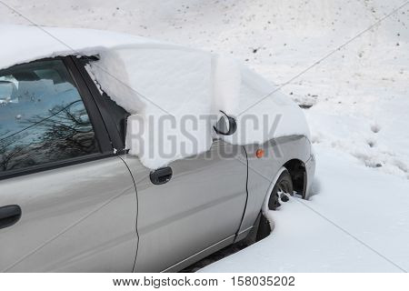 Car stuck in snow after snowstorm in the winter