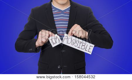 Businessman tear up paper Impossible for concept of successful challenges and positive attitude