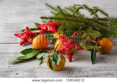 Tangerines, Fir Tree Brunches, Pine Cones And Nuts. Christmas Food Decorations. Table Setting.