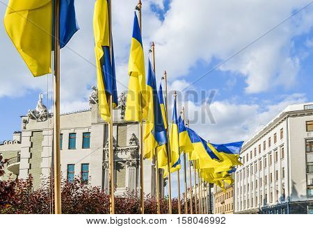 Kiev, Ukraine - May 25, 2013: Bankova street with several Ukrainian government buildings such as President's administration with flags