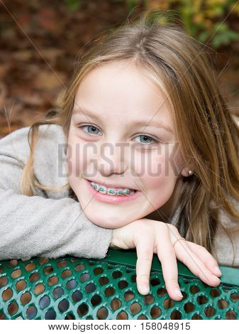 Pretty Blond Girl Smiling With Dental Braces