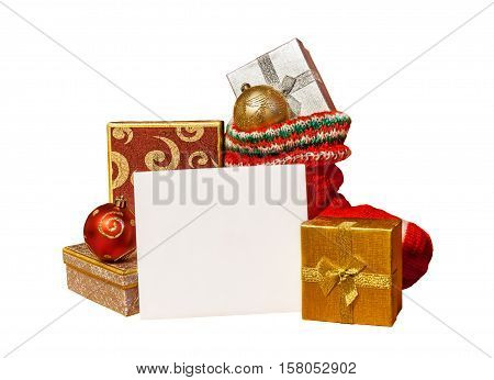 Christmas stocking with presents and greeting card isolated on white background. Selective focus
