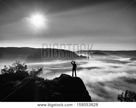 Young Sportsman Shadowing His Eyes From The Bright Light Of The Daybreak Sun