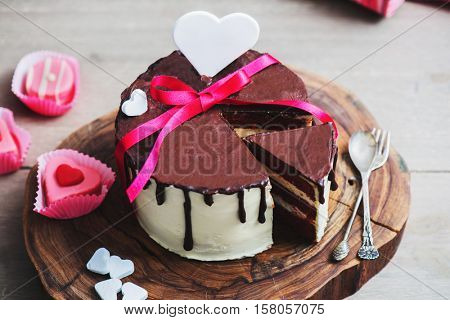 Slice of a Valentine Day cake with heart shaped decoration