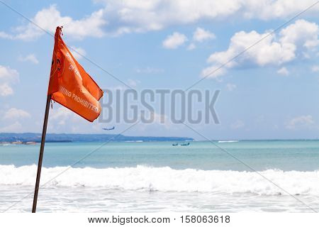 BALI / INDONESIA - NOVEMBER 23 2013: warning flag ( swimming prohibited ) stands on a beach at bali / indonesia