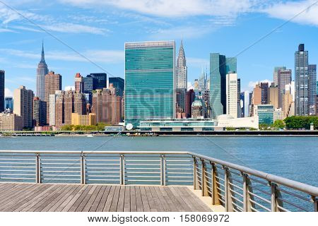 View of the midtown Manhattan skyline on a beautiful summer day from a pier in Queens