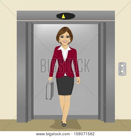 young beautiful businesswoman with briefcase coming out of the office building elevator