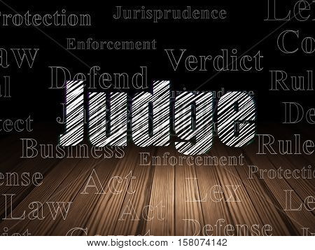 Law concept: Glowing text Judge in grunge dark room with Wooden Floor, black background with  Tag Cloud