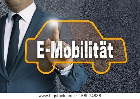 E-mobilitaet (in German E-mobility) Touchscreen Is Shown By Businessman