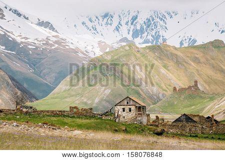 Old Empty Abandoned Village With Dilapidated Houses In Truso Gorge, Kazbegi District, Mtskheta-Mtianeti Region, Georgia. Spring Or Summer Season