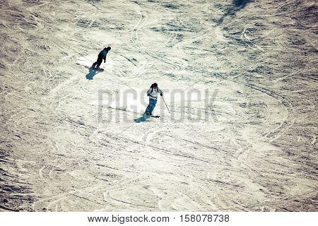Man skiing on slope - winter holidays
