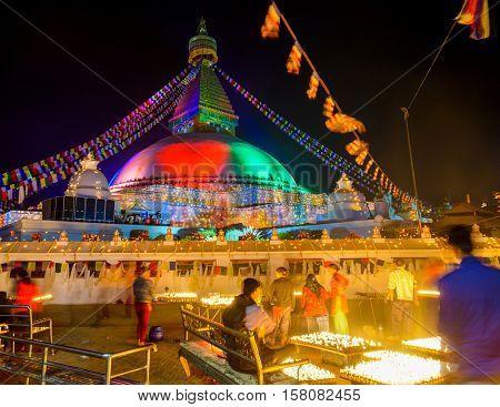 KATHMANDU, NEPAL - NOVEMBER 21, 2016: The renovated Boudhanath stupa is lit for its inauguration.