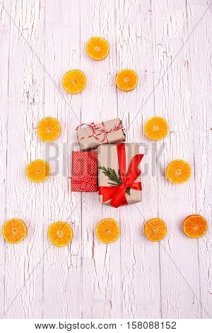 Present Boxes For Christmas Lie In The Triangle Of Oranges