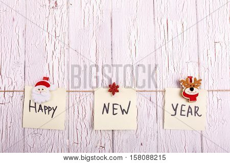 Cards With Words 'happy New Year' Hang On The Rope