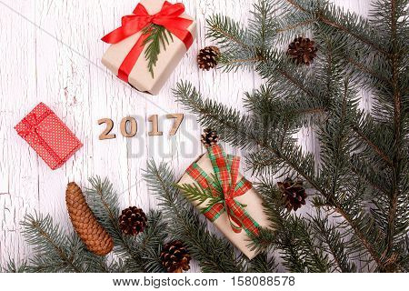Wooden Number 2017 Lies In A Circle Of Fir Branches And Present Boxes