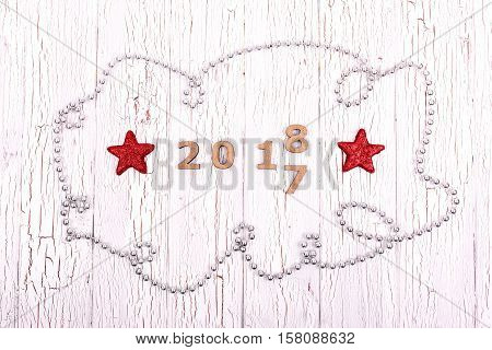 Garland Of Little Silver Pearls Lies Around Wooden Numbers 2017 And 2018