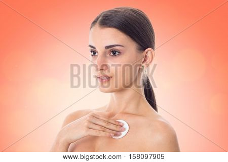 lovely Young girl takes care her skin with Cleansing cotton pad isolated on white background. Health care concept. Body care concept. Young woman with healthy skin.