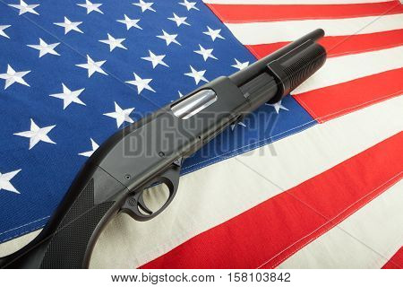 Shotgun without any signs over USA flag