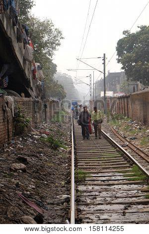 KOLKATA, INDIA - FEBRUARY 10: People walking on the railroad in Kolkata, India on February 10, 2016.