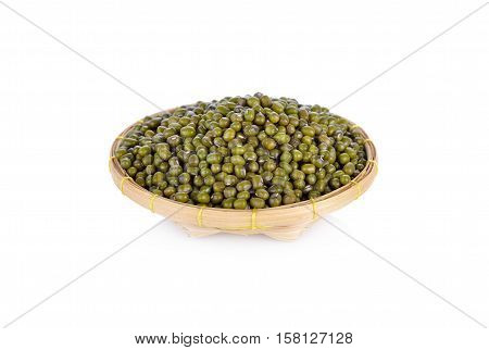 green mung beans in bamboo basket on white background