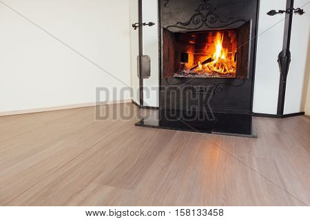 burning fireplace in cozy room