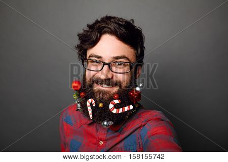 Close up Male geek wearing glasses ready to celebrate for New Years or Christmas over grey background