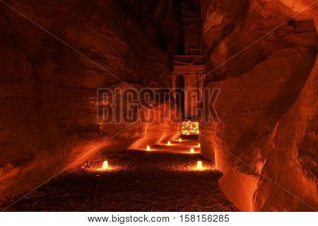 Illuminated Path to The Treasury (Al Khazneh) of Petra Ancient City, Jordan