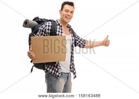 Young hitchhiker holding a blank cardboard sign isolated on white background