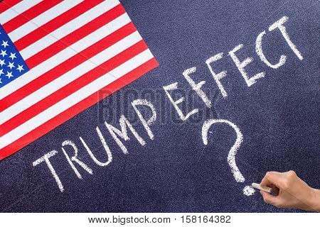 Trump Effect on the chalk board and US flag. Election concept