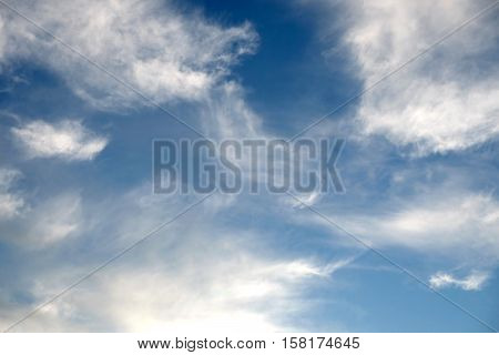 Beautiful celestial landscape with white clouds high in the stratosphere on a sunny summer day horizontal photo