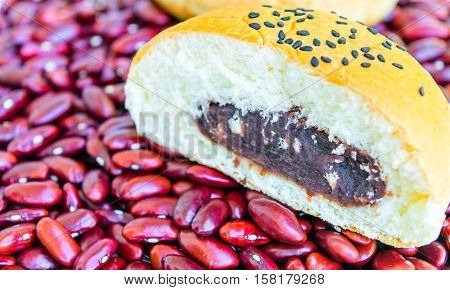 Bread stuffed with red beans. Sprinkle with sesame seeds. on red beans