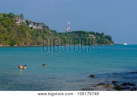 Beautiful landscape seaview with a boat at beach of Laem Panwa Cape famous attractions in Phuket island, Thailand