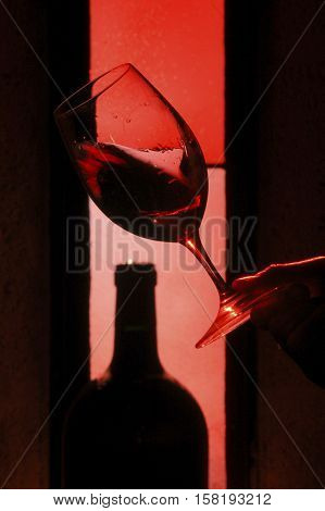 Tasting glass of red wine in a cellar France