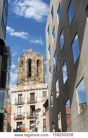Barcelona (Catalunya Spain): a street in the gothic quarter with old and modern buildings
