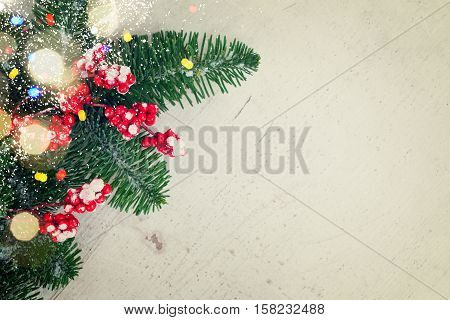 red and white christmas - twig with red berries and gree evergreen tree twig with copy space, retro toned