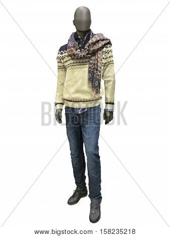 Full-length male mannequin dressed in sweater scarf and jeans isolated on white background.