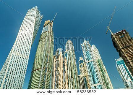 DUBAI UAE - NOVEMBER 7 2016: Luxury scyscrapers in marina Dubai Unidet Arab Emirates. Dubai Marina in a summer day United Arab Emirates.