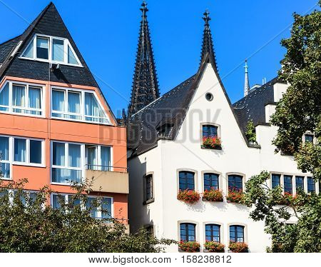 A row of picturesque gabled houses on the banks of the Rhine in Cologne, Germany