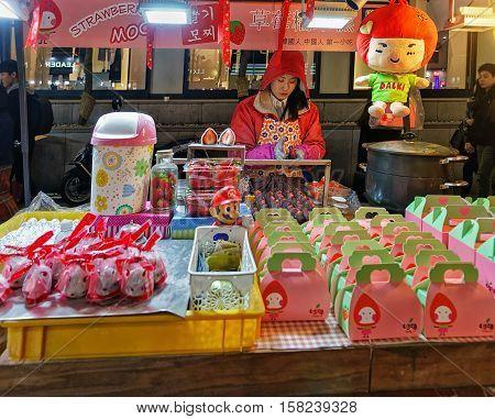 Female Seller Of Mochi At Myeongdong Street Market In Seoul