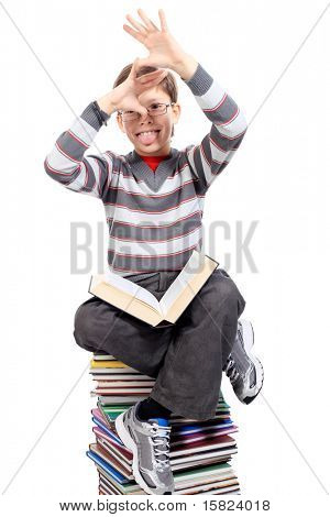 Educational theme: portrait of a shouting schoolboy with books. Isolated over white background.