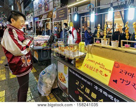 Girl Buying Sweet Potato In Myeongdong Open Street Market Seoul